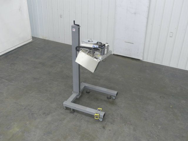 Domino M-Series Print and Apply Pressure Labeler